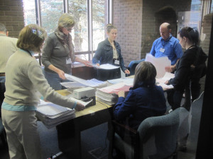 Workers at the state elections office ready petitions for the counting of signatures.