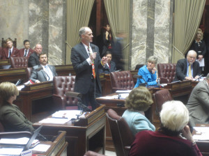 New Majority Leader Rodney Tom, D-Bellevue, makes a first move on the Senate floor.