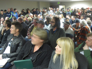 An enormous crowd packs the hearing room at state Liquor Control Board headquarters Tuesday night.