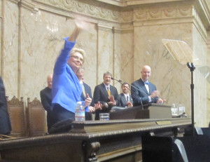 Gov. Christine Gregoire waves to the crowd as she prepares to deliver her 8th and final state of the state address.