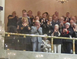 Who's the man in the gray suit? That's former Gov. Mike Lowry, watching from the gallery.