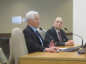 Insurance Commissioner Mike Kreidler, left, testifies before the House Health Care Committee Friday.