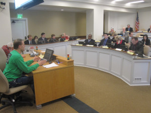 Tim Eyman, in green, makes his point to the Senate Transportation Committee.