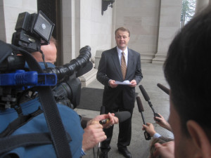 Initiative promoter Tim Eyman speaks with reporters at one of the day's many news conferences.