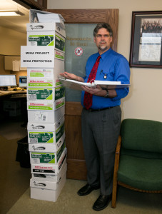 """Mega Project, Nega Protection"": State Rep. Ed Orcutt, R-Kalama, stands alongside the eight boxes of documents he got from the Department of Transportation when he requested information about the 520 pontoon problem."