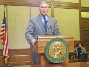 Washington Gov. Jay Inslee addresses reporters at a news conference early this session.