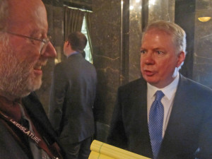 State Sen. Ed Murray, D-Seattle, chats with reporters after the big to-do.