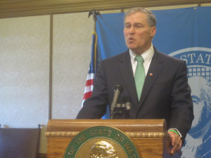 Gov. Jay Inslee meets with reporters Wednesday.