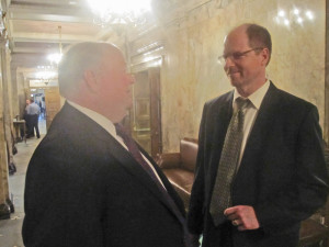 New House Minority Leader Dan Kristiansen, R-Snohomish, right, confers with fellow Republican Joe Schmick of Colfax.