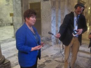 State Sen. Pam Roach, R-Auburn, speaks with reporters Sunday night.