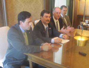 At a media availability following the debate, Senate Republican Leader Mark Schoesler, R-Ritzville, second from left, says the reform bills are worth the argument. He is flanked by Sen. Andy Hill, R-Redmond, Senate Majority Leader Rodney Tom, D-Medina, and Sen. Jon Braun, R-Centralia.