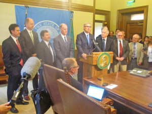 Flanked by leaders an budget negotiators in both parties, Gov. Jay Inslee says there really is a deal.