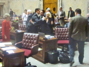 Senate budget-writer Andy Hill is surrounded by well-wishers in the moments after the budget bill passed the Senate Friday.