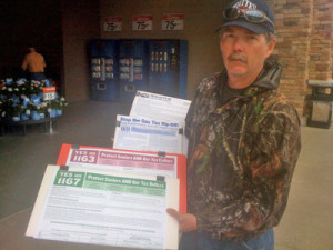 Paid canvasser displays his wares at a Wal-Mart store in 2011.