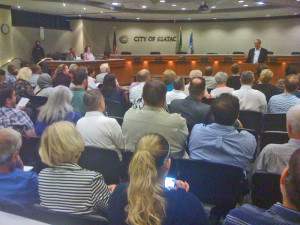 Doubletree Hotel manager Frank Welton speaks to a standing-room-only crowd at Sea-Tac City Hall Tuesday night.