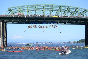 They shall not pass: Flotilla greets protesters on bridge. (Portland Rising Tide)