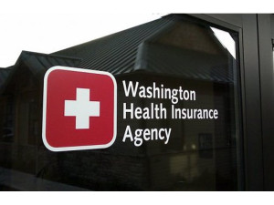 Sign on door of Bonfield's Tumwater insurance agency identifies it as Washington Health Insurance Agency.