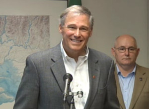 Inslee appears at the Seattle news conference. (From TVW live webcast feed.)