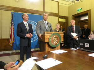 As Boeing Co. officials watch approvingly from a corner of the conference room, Gov. Jay Inslee announces a deal he says will stop the aircraft maker's flight to South Carolina.