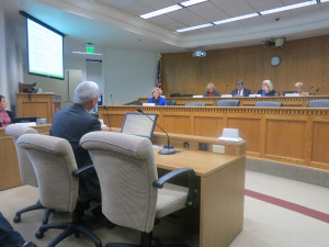 Richard Onizuka, CEO of the Washington health benefits exchange, testifies before the Senate Health Care Committee Thursday.