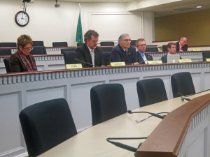 The Climate Legislative and Executive Workgroup holds a public hearing last week. Left to right, state Rep. Liz Pike, R-Camas, filling in for Shelley Short, R-Addy, Sen. Kevin Ranker, D-Orcas Island, Gov. Jay Inslee, Sen. Doug Ericksen, R-Ferndale, and Joe Fitzgibbon, R-Des Moines; non-member Rep. Jake Fey, D-Tacoma is in second row.