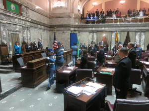 Color guard procession marks the start of business in the Senate.