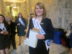 It only seemed like Business-and-Jobs Day at the statehouse. Officially it was Dairy Day. Here alternate dairy ambassador Olivia Zurcher of Mesa performs official duty with a box of free ice-cream bars.