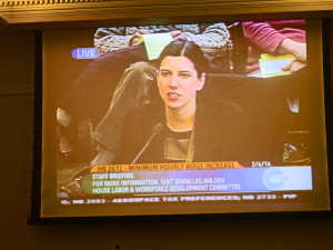 The view from the overflow room: Sponsor Jessyn Farrell, D-Seattle, makes her pitch.