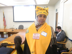 Shukri Hashi, minimum-wage worker at SeaTac International Airport's Hudson News concession, was among a 60-member contingent at the hearing from the United Food and Commercial Workers union.