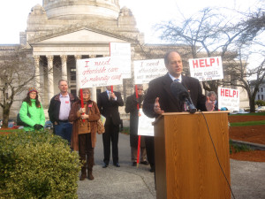 Steve O'Ban speaks at a news conference launching the campaign for out-of-state insurance sales.