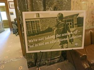 A sign that has been posted outside the door of the Senate Democratic Caucus room no doubt was intended as comment on the Supreme Court's order to the $5 billion funding plan it has ordered lawmakers to develop for the K-12 schools. But it certainly seems ironic now.
