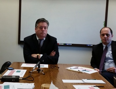 OFM Director David Schumacher meets with reporters Tuesday.