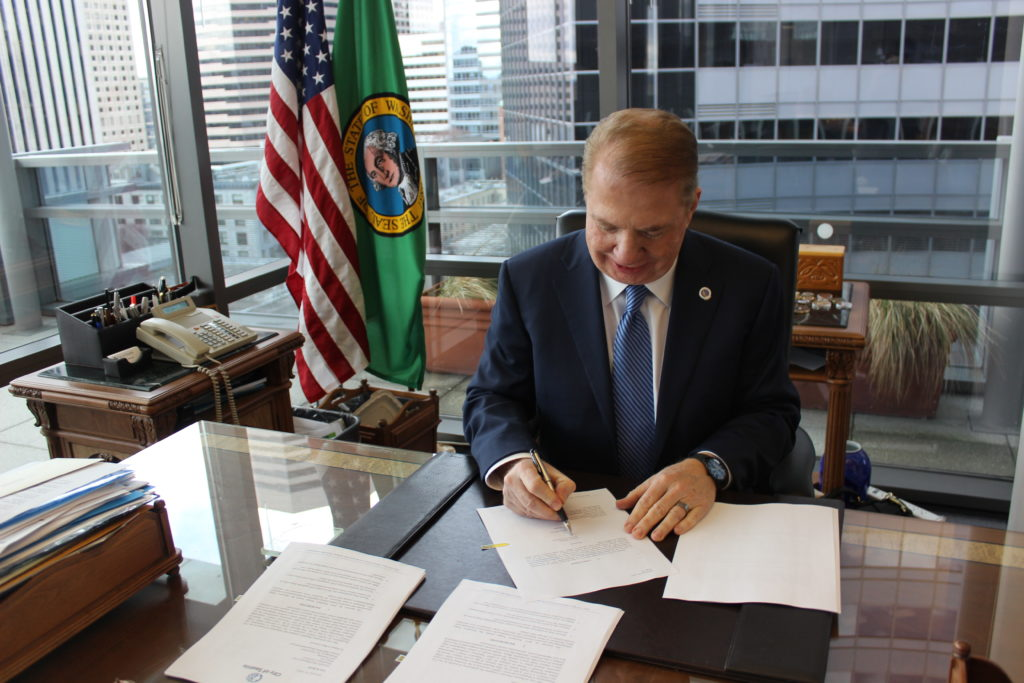 Mayor Ed Murray signs off on FOIA requests directed at the Department of Homeland Security regarding President Donald Trump's travel ban executive order. (Photo courtesy of Mayor Ed Murray's office.)